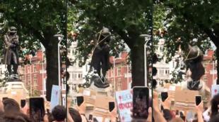 Des personnes manifestant contre le racisme déboulonnent à Bristol, le 7 mai 2020, la statue d'Edward Colston, un négrier qui s'est enrichi par le commerce d'esclaves.