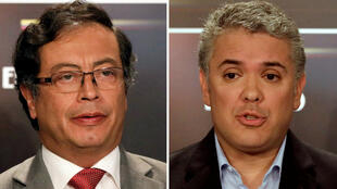 Una combinación de fotos muestra a los candidatos presidenciales colombianos Gustavo Petro e Ivan Duque durante un debate presidencial en Bogotá, Colombia el 24 de mayo de 2018.