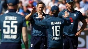Wicket-taker: England's Chris Woakes (C) celebrates his dismissal of Pakistan's Imad Wasim in a return of four for 67 during Tuesday's 3rd ODI in Bristol