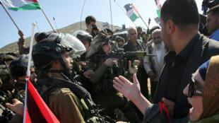 Des soldats israéliens dispersent une manifestation en Cisjordanie, le 10 décembre 2014.
