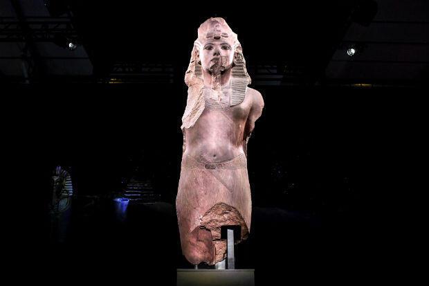 A sculpture of 'Tutankhamun usurped by Horemheb' at the Grande Halle de la Villette in Paris on March 21, 2019.