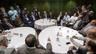 UN Special Envoy of for Yemen Ismail Ould Cheikh Ahmed (C) sits with Yemeni rebels on June 16, 2015 in Geneva.