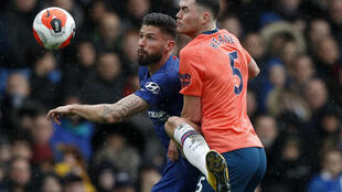 Still training: Everton defender Michael Keane (R) pictured in action against Chelsea's Olivier Giroud (L)