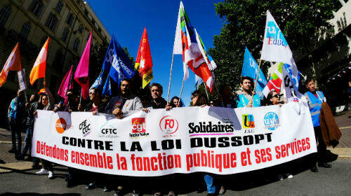 "French workers march against a government bill supposed to ""modernise"" the status of civil servants on May 9, 2019 in Marseille."