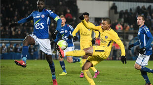 Paris Saint-Germain's French forward Kylian Mbappe kicks the ball during the French L1 football match between Strasbourg (RCSA) and Paris Saint-Germain (PSG) at the Meinau Stadium in Strasbourg, eastern France, on December 2, 2017.