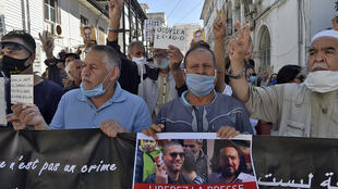 An Algerian demonstrator held up a sign reading in French 'Free the Press' at a protest in the capital Algiers calling for the release of jailed journalist Khaled Drareni in September