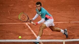Hugo Gaston face au Suisse Stan Wawrinka au 3e tour de Roland-Garros, le 2 octobre 2020