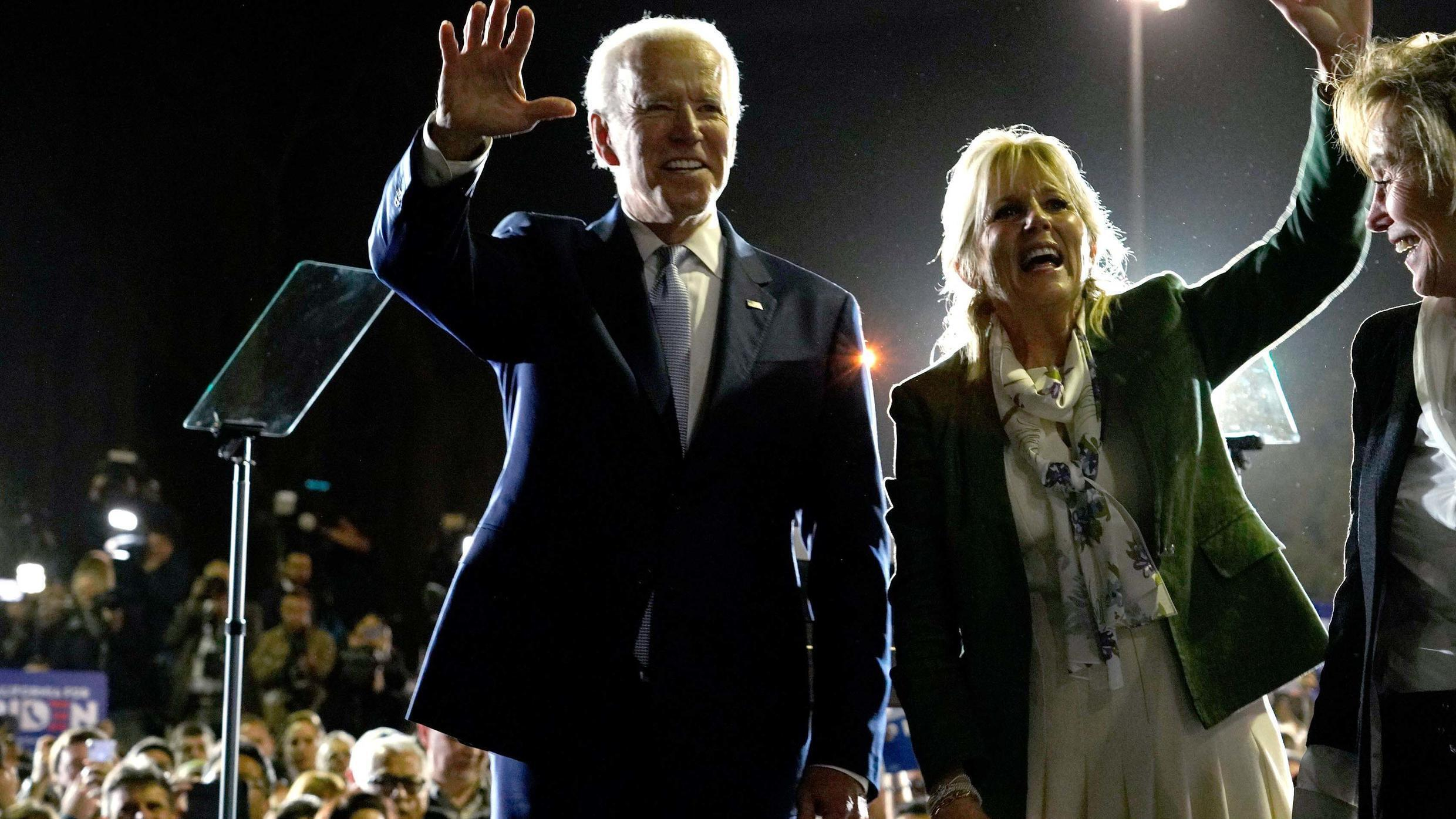 Democratic U.S. presidential candidate and former Vice President Joe Biden waves with his wife Jill at his Super Tuesday night rally in Los Angeles, California, U.S., March 3, 2020.