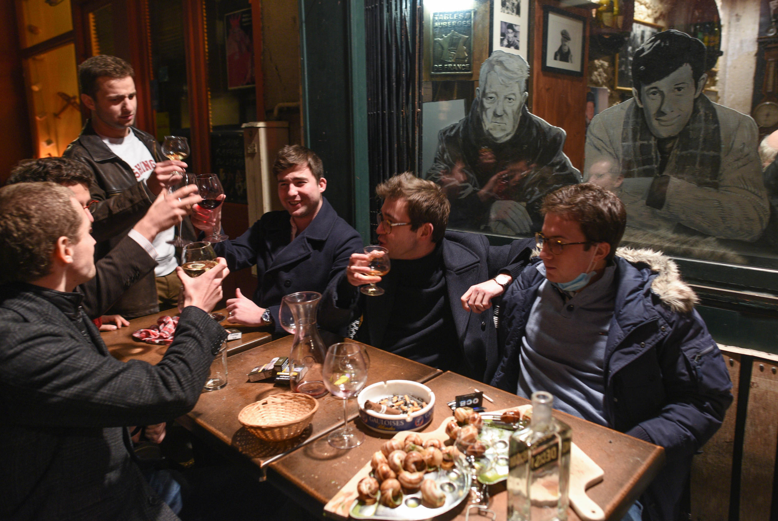 People enjoy a last night out on October 16 in Paris before the Covid curfew comes into effect.