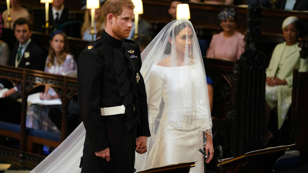 Britain's Prince Harry and his US fiancée Meghan Markle stand together for their wedding in St George's Chapel, Windsor Castle, Windsor, on May 19, 2018.