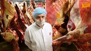 Patrice Monguillon, pictured in 2011 in front of beef carcasses and former managing director of Spanghero's site at Castelnaudary, southwestern France, faces up to ten years in jail with his three fellow accused