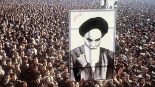 Protesters carry a giant portrait of Ayatollah Ruhollah Khomeini at a demonstration against the shah in Tehran in January 1979