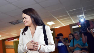Presidential candidate Svetlana Tikhanouskaya reacts after casting her ballot at a polling station during the presidential election in Minsk on August 9, 2020.