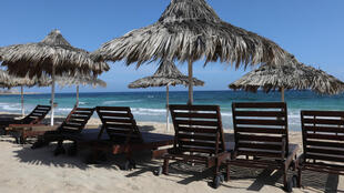 Empty sunbeds on a beach in the Cypriot resort of Ayia Napa await the return of tourists