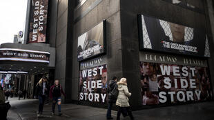 """A poster outside the Broadway Theater advertises the popular musical """"West Side Story"""" in pre-COVID-19 New York City"""