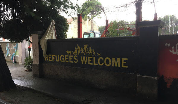 "A ""Refugees Welcome"" graffiti outside Porto San Giorgio's town hall."