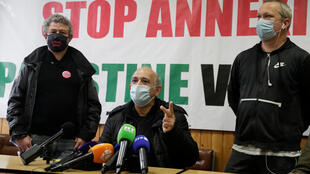 Walid Atallah, centre, president of the Association of Palestinians in the Ile-de-France region, at a press conference in Paris