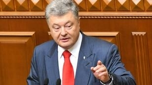 Ukrainian President Petro Poroshenko is suing British broadcaster BBC for libel