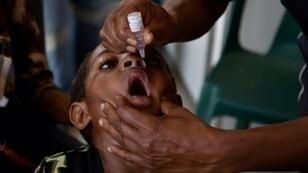 Six-year-old Warapnong Ponde is given a polio vaccination in a mobile clinic in rural Papua New Guinea, as the impoverished country fights a new outbreak of a disease which had previously been eradicated
