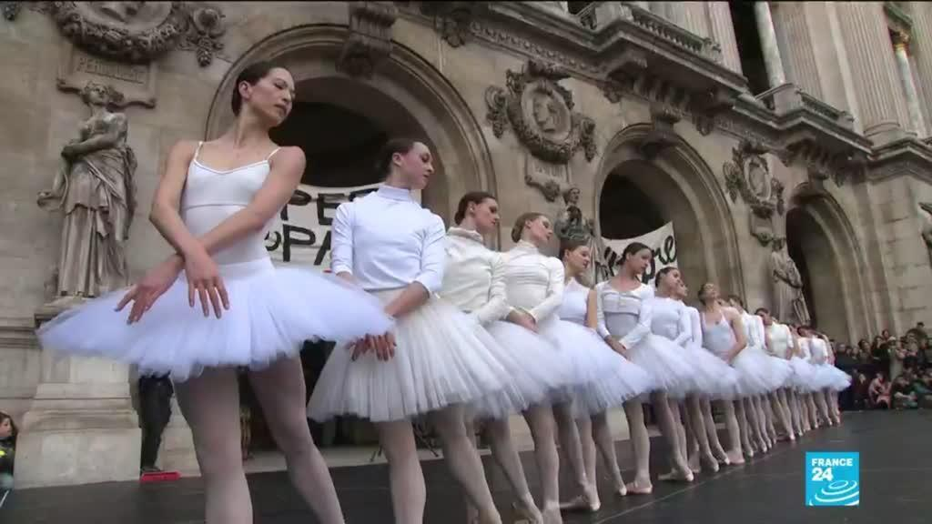 Ballerinas dance scenes from Swan Lake on the forecourt of the Palais Garnier in Paris to protest Macron's pension reform plan.