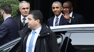 Barack Obama leaves his hotel in central Paris before going to l'Élysée Palace on Saturday, December 2.