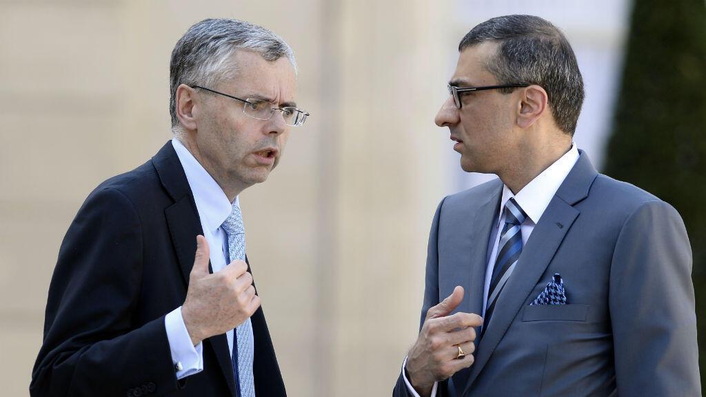 Michel Combes, directeur général d'Alcatel-Lucent, et Rajeev Suri, PDG de Nokia dans la cour de l'Elysée le 14 avril.