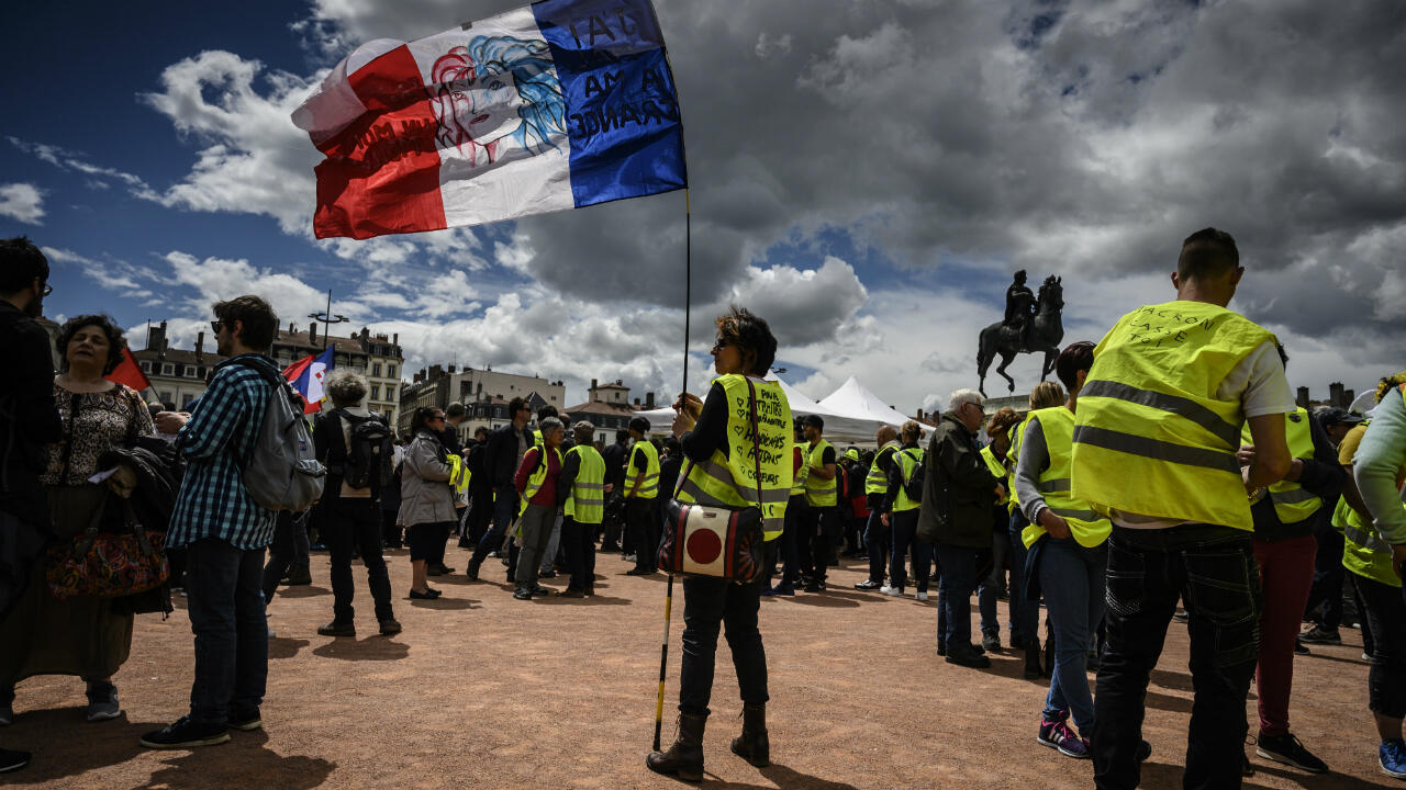 Yellow Vest protesters gather on Bellecourt square in Lyon on May 11, 2019.