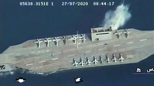 An image grab from Iranian State TV IRIB footage reportedly shows an Iranian mockup of a US aircraft carrier being hit during a military exercise