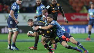 Chiefs captain Aaron Cruden (C) lamented his side's execution under pressure as they went down to the Auckland Blues 24-12