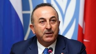 FILE PHOTO: Turkish Foreign Minister Mevlut Cavusoglu attends a news conference in Geneva, Switzerland, October 29, 2019.