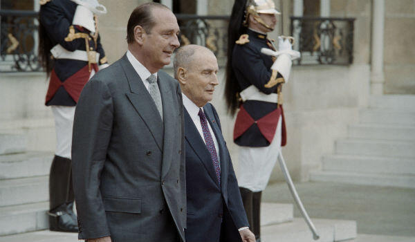 Jacques Chirac escorts outgoing president François Mitterrand.