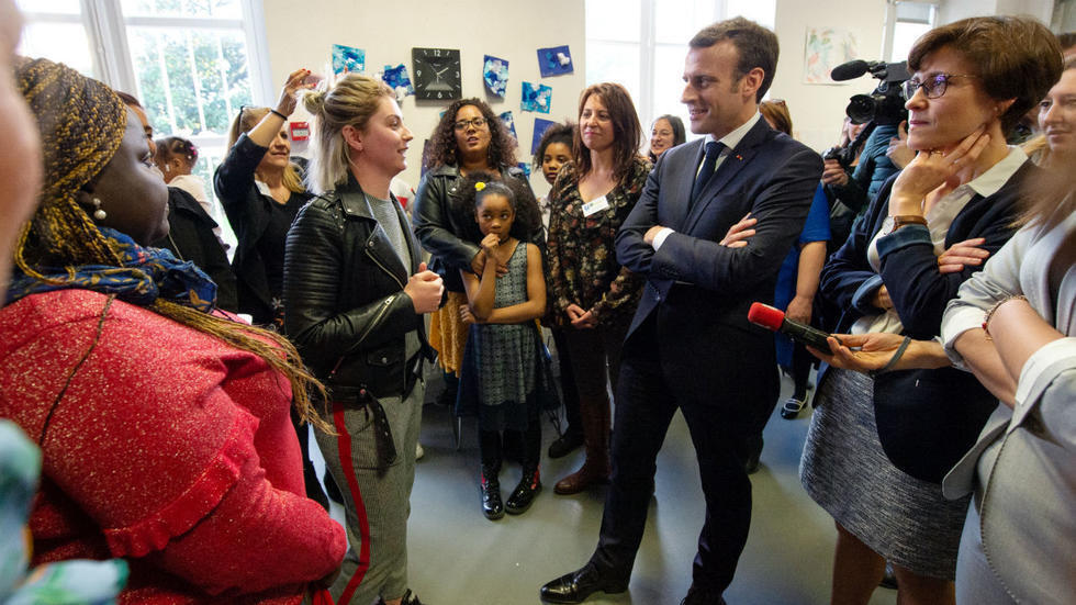 """French President Emmanuel Macron visits a professional integration centre as part of the """"Great National Debate"""" in Bordeaux on February 28, 2019."""