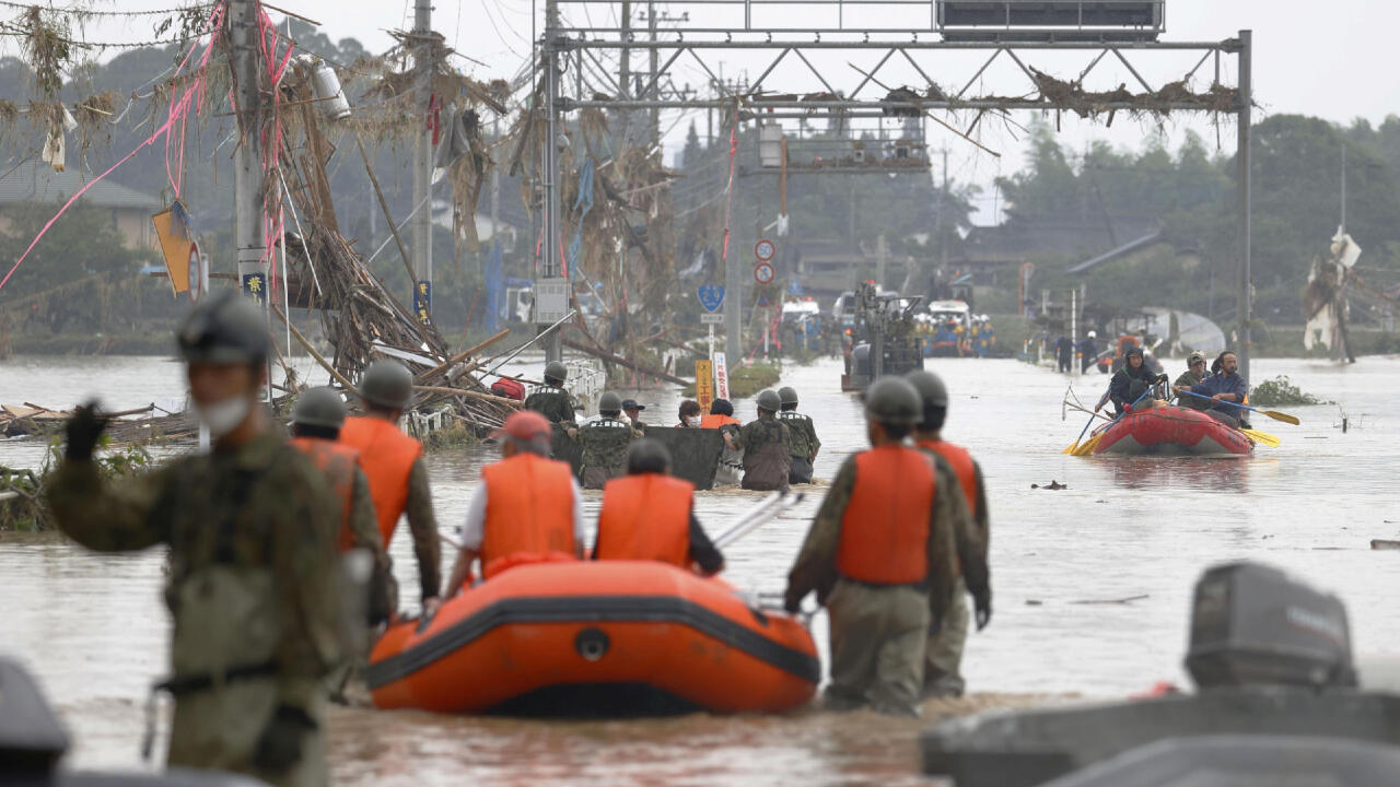 Local residents are rescued by Japanese self-defence force soldiers using a boat at a flooding area caused by a heavy rain in Kuma village, Kumamoto prefecture, southern Japan, in this photo taken by Kyodo July 5, 2020.