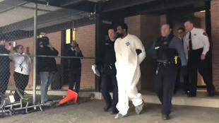 Grafton Thomas, a suspect in an attack at a Hasidic rabbi's home, walks from Ramapo jail to be arraigned on five counts of attempted murder in a state court in Ramapo, New York, U.S. in a still image from video December 29, 2019.
