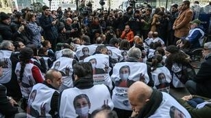 Protesters wore vests bearing images of hunger striking lawmaker Leyla Guven