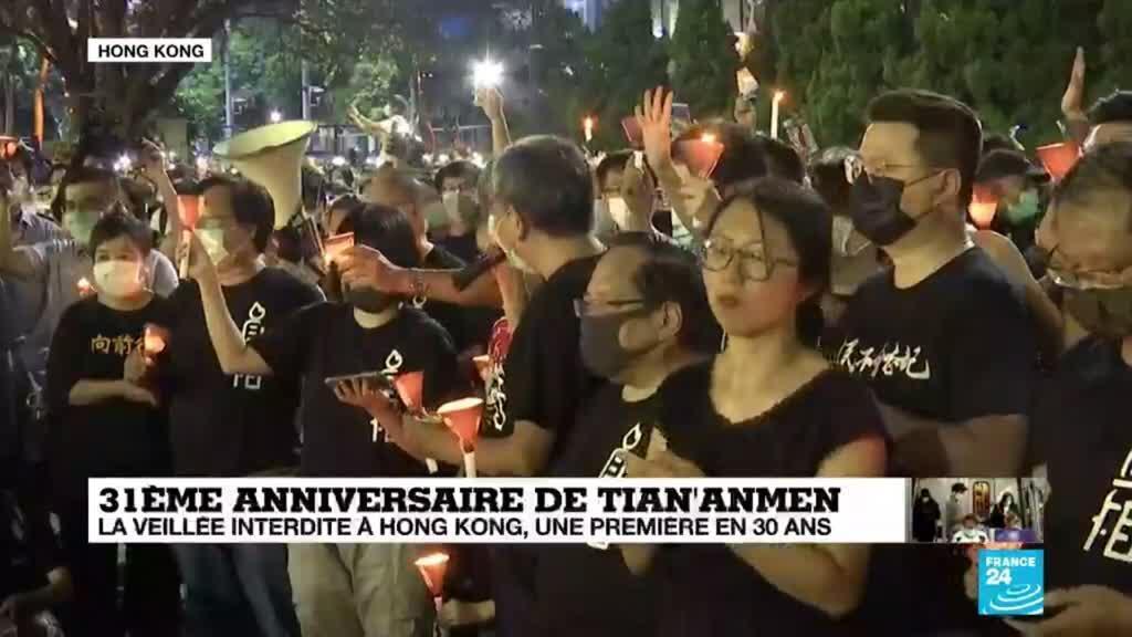 2020-06-04 14:11 Tiananmen : des milliers de personnes bravent l'interdiction et allument des bougies à Hong Kong