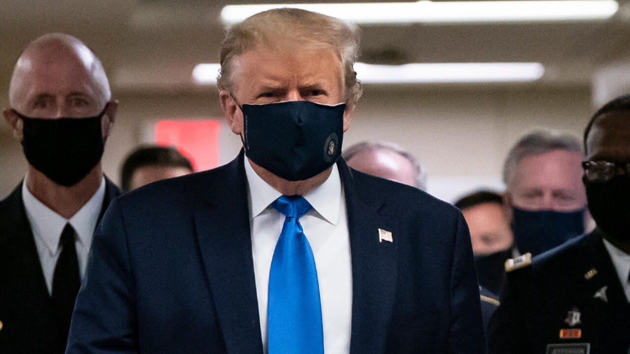 Trump finally wears face mask in public during hospital visit