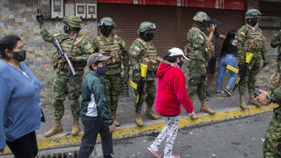 Ecuadorean soldiers wearing facemasks take part in a coronavirus public education operation in the capital, Quito