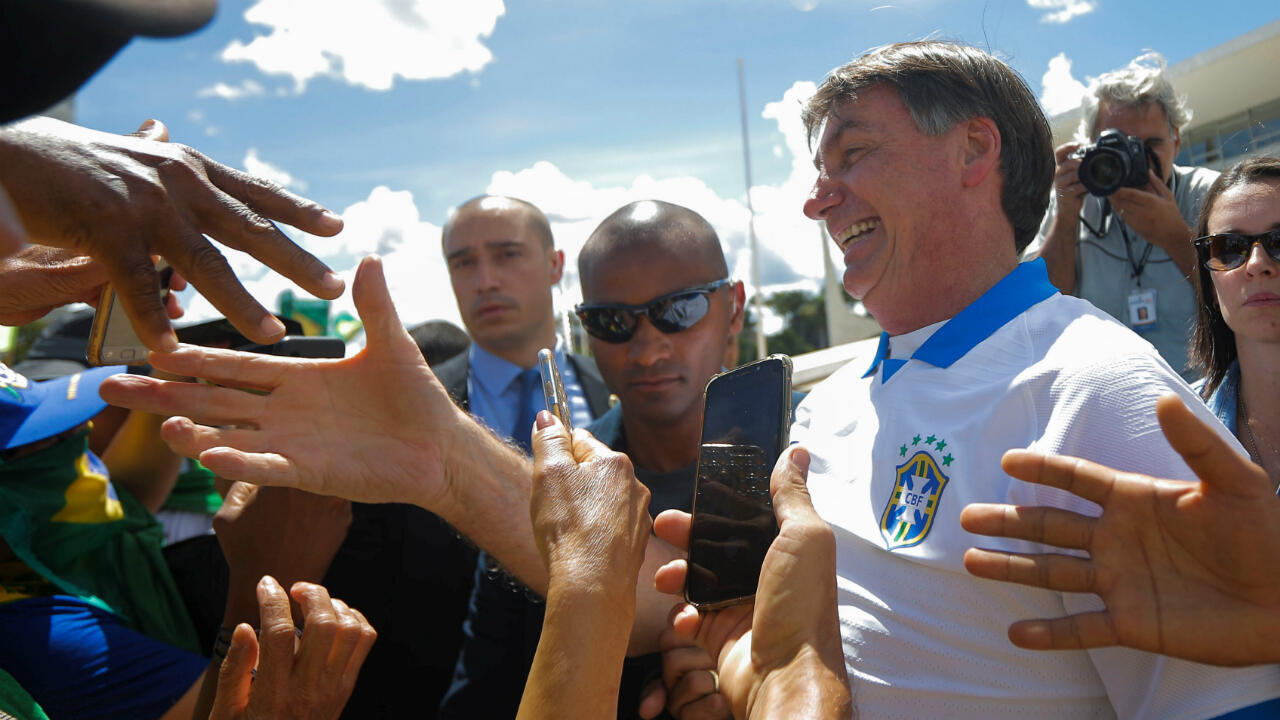 Brazil's President Jair Bolsonaro meets supporters during a protest against Brazil's Congress and Brazilian Supreme Court in front the Planalto Palace in Brasilia, Brazil March 15, 2020.