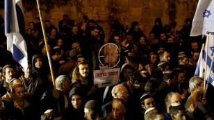 Right-wing Israelis, mostly from settlements in the occupied West Bank, protest outside the residence of Prime Minister Benjamin Netanyahu in Jerusalem