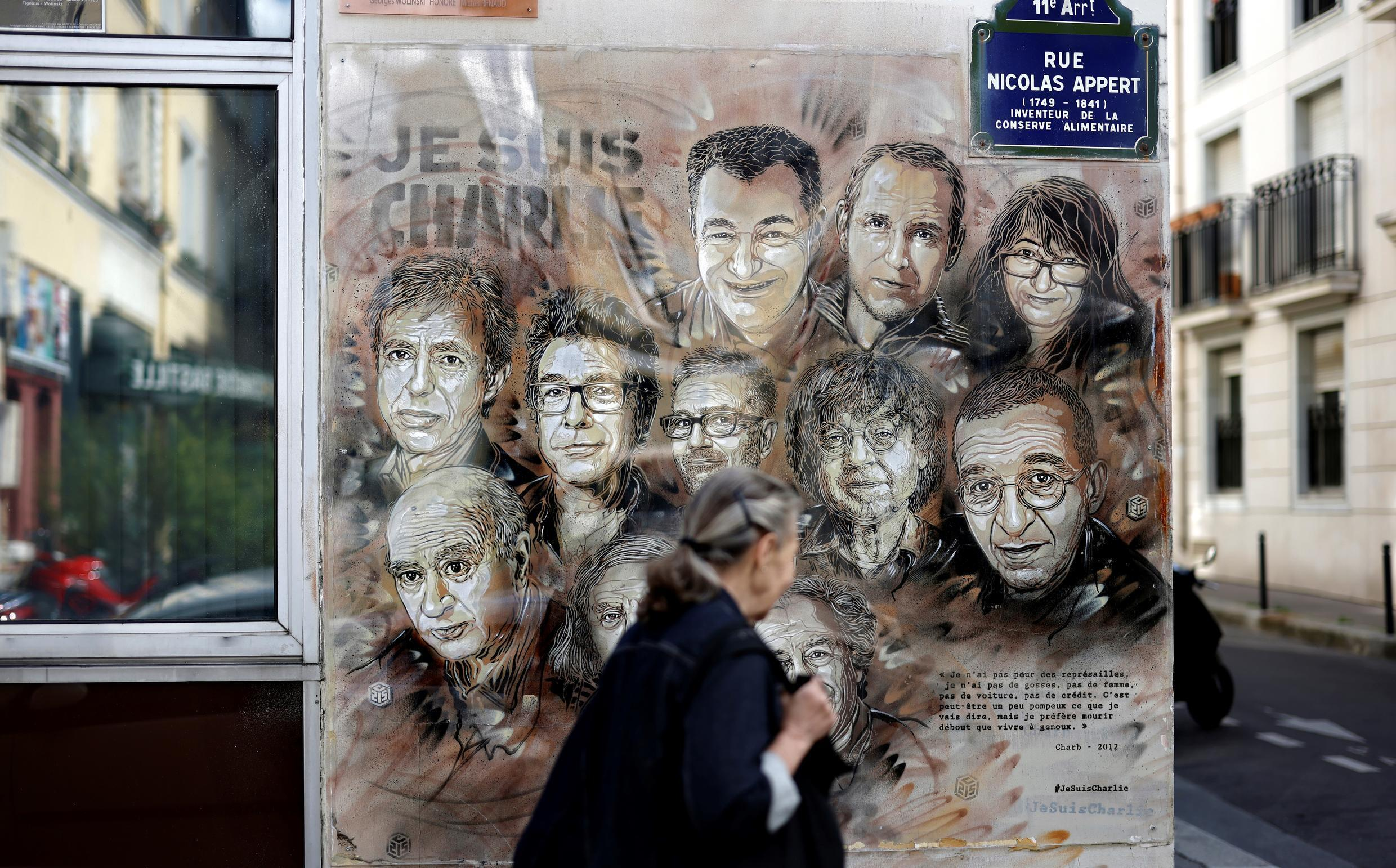 A painting by French street artist Christian Guemy, known as C215, in tribute to the Charlie Hebdo journalists and cartoonists who were killed by jihadist gunmen in January 2015.