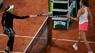 Tapping out: Jelena Ostapenko with Karolina Pliskova at the end of Thursday's match