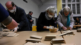 Counting at a polling station in Strasbourg, France, March 14, 2020.