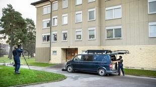 Police at the scene of an apartment on December 1, 2020, in Haninge, south of Stockholm, where a woman is suspected of having kept her son locked up for 28 years.