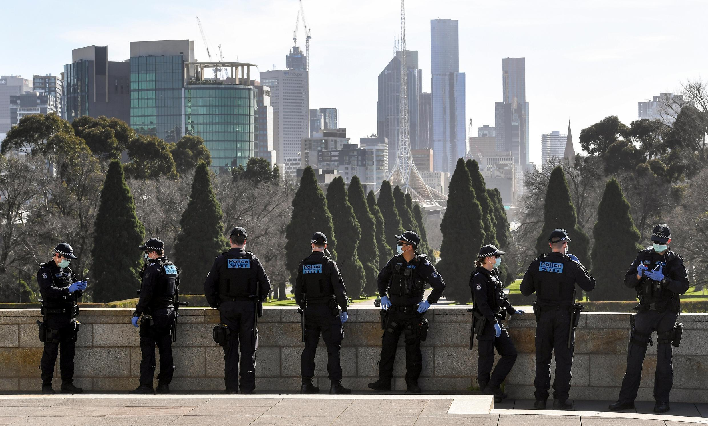 Police patrol The Shrine of Remembrance enforcing the wearing of face masks in Melbourne, Australia on July 31, 2020.