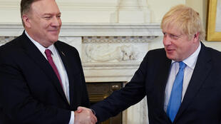 US Secretary of State Mike Pompeo shakes hands with Britain's Prime Minister Boris Johnson as they meet at Downing Street in London on January 30, 2020.