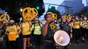 2020-07-23T045900Z_1744177165_RC2SYH9C4GAD_RTRMADP_3_GLOBAL-RACE-PROTESTS-PORTLAND
