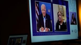 A video screen for members of the news media featuring US President-elect Joe Biden as he sits in a nearby room in Wilmington, Delaware, on December 2, 2020, on a video call with small business owners and workers impacted by the current economic crisis.