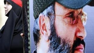 File photo shows a billboard depicting slain Hezbollah commander Imad Mughniyeh.