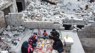 Tareq Abu Ziad and his family had to flee their hometown of Ariha as Syrian regime forces closed in -- but they returned to their destroyed home for a Ramadan meal